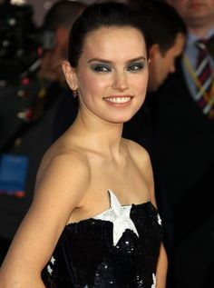 Daisy Ridley kept the theme going with shimmering blue eyeshadow and Selim Mouzanna star earrings