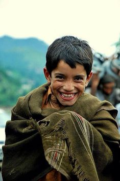 A colt smiles, on a cold rainy evening in Hunza Valley