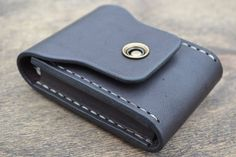 Beautiful and practical mini wallet made from full grain leather. Perfect for credit cards and folded bills. Closing of a button. If you do not like big wallets, this wallet for you to find. Wallet hand sewn two needle stitch. Impregnated with natural linseed and castor oil. It can be worn on a belt in two different ways. A holder with carabiner directly or threading a the belt through the belt loops on the back side of the wallet.   Take another look in a different color Here you can see…