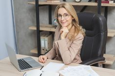 Happy portrait of a smiling young businesswoman sitting on chair at workplace with laptop and papers on table , Mail Marketing, Facebook Marketing, Inbound Marketing, Laptop, Pinterest Marketing, Free Photos, Business Women, Workplace, Portrait