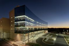 The Texas skyline reflects off the glass of the Louis & Peaches Owen Heart Hospital. Photo: © Aker Imaging, Houston
