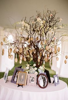 Guests found their seats using wooden escort cards made by the groom and displayed on a tree surrounded by photos of the couple's parents and grandparents on their wedding days. Photo by Robert Sukrachand.