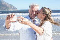 Health - Married couple at the beach together taking a selfie (pane 3 option)