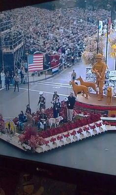 "Love, love, love this! Honoring our 4-legged Heroes! Bless them all! ""Here is the Canines of Courage float in this years Tournament of Roses Parade. One of our favorite dog teams is representing Retired Military Working Dogs Everywhere. Chuck Shuck and his dog Retired MWD Gabe. Such a honor to have such great friends throughout the MWD community! GABE you look pretty darn PAWSOME if we do say so ourselves..."