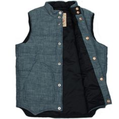 Monitaly Chambray Vest. A lot of vests been around but nothing as unusual as a chambray vest. It is internally lined with Primeloft and the press studs are backed with leather closure on front. Exc...