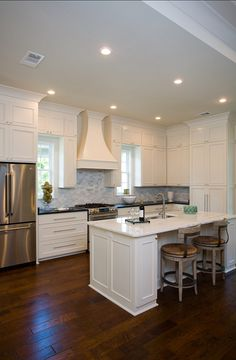 Fantastic from top to bottom! Beautiful cabinetry, marble subway tile, and dark-ish floors