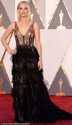 Racy in lace: Best Actress nominee Jennifer Lawrence was one of the last celebrities to arrive, wearing a black Dior Haute Couture gown