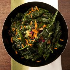 Kale Salad with shredded carrots, dried cranberries, raisins and walnuts!