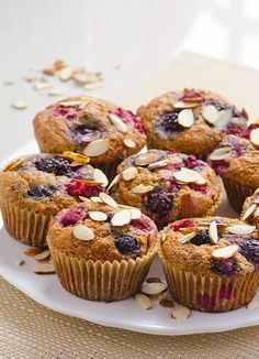 Berry Almond Muffins -- So fluffy, moist and delicious, you won't believe these muffins are healthy. They are gone in 1 day every time I bake them. #cleaneating