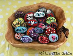 Painted Rocks- not only are the so pretty I love what they did with them- they putt them in a bowl by the front door & whenever someone comes over and comments on them- they asked the guest to take one home with them! What a great idea & wonderful way to share some happiness!