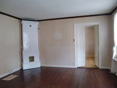 This tile stove measure 2.80 meters (9.18 feet) and it works perfectly. All the walls in this room is also covered with masonite boards.