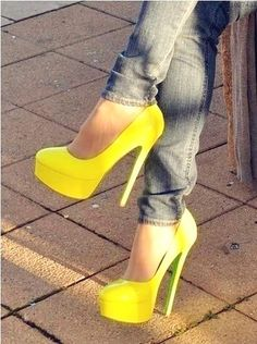 Lemon Yellow Stiletto Heel Pumps with round vamp and toe and hidden platform. These monochromatic women's high heeled shoes, worn with blue jeans, show a ray of sunshine in their trending style.