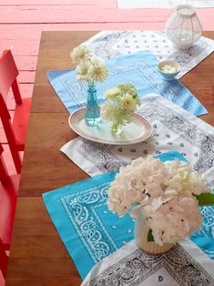 Give your picnic table a 4th of July makeover with patriotic table decorations. A runner of neatly pressed bandannas in hues of blue and white looks fresh, especially when paired with pretty floral centerpieces. #redwhiteandblue #4thofjuly #4thofjulyparty #partyideas #4thofjulydecorations #bhg Patriotic Table Decorations, Paper Decorations, Fourth Of July Decor, 4th Of July Party, July Flowers, Fun Dip, Flag Decor, Outdoor Parties, Paper Lanterns