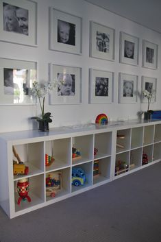 Bookcase for storage and bench, black and white photos above.