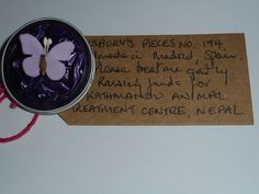 Pillsbury's Pieces No, 194. Pin with purple capsule with lilac butterfly. In exchange for a donation to KATHMANDU ANIMAL TREATMENT CENTRE, Nepal. Available at St. George's Church, Madrid on Saturday 13 June from 11.00 - 15.00.