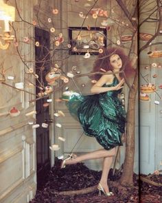 tim walker, I really like this, a tea party with vintage crock etc.. and a small tree with cakes hanging off, quite surreal and dreamy