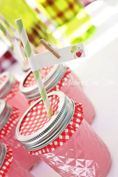 "Strawberry lemonade with cupcake liners used for ""lids"" and adorable strawberry straw flags."