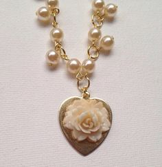Golden Flower and Pearl Charm Necklace by ClaireFlair on Etsy