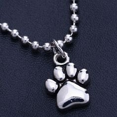 Little Silver Dog Foot Print Necklace; chain length 19inches; at DogsOnlyClub.com