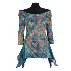 "Peacock Sequin Top Exclusive! Fine Feathers.The shimmery peacock print of this off-shoulder top is paneled in front with featherlight ""fur"" and crisscrossed with tiny sequins. The arced hemline falls slightly longer in back. Three-quarter sleeves. Stretchy polyester/rayon/spandex. Dry clean. Made in USA."