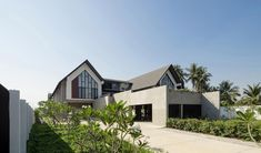 "A rural home designed for a retired doctor and his family in the west of Thailand Architects: ForX Design Studio Location: Ratchaburi, Thailand Year: 2017 Photography: ©Tinnaphop Chawatin Description: ""Situated away from the town, the house only occupies half of the land; leaving the surrounding as green open space with existing coconut and fruit trees which camouflage …"