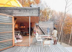 Outdoor clothing designers Setsumasa and Mami Kobayashi built this weekend retreat in the Chichibu mountain range northwest of Tokyo from locally harvested larch wood and removable fiberplastic walls. The 'platform for living' (not to be referred to as a house) runs on solar energy and has electricity, hot water, wifi, iPads and other bare necessities. The yellow not-quite-geodesic dome tents are the bedrooms.