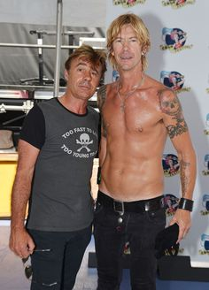 Duff McKagan Photos Photos - Glen Matlock of the Sex Pistols and Duff McKagan of the band Loaded pose for a picture backstage at the 2012 CBGB Festival on July 7, 2012 in New York City. - 2012 CBGB Festival In Times Square