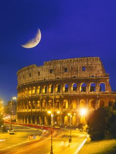 A poster of the Colosseum at night.  The Colosseum is built in the shape of an oval. Most amphitheaters are circular, but the Colosseum is an oval to ensure that everyone would be able to see well.  (http://colosseum.pbworks.com/w/page/16155807/Architecture)