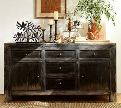 Like an antique chest that has been retrofitted to function as a media console, these pieces blend timeworn character with modern functionality. Details like mitered corners, and molding-trimmed drawers and doors lend dimension to the design, and the rustic finish is weathered and distressed to reveal hints of the wood grain.