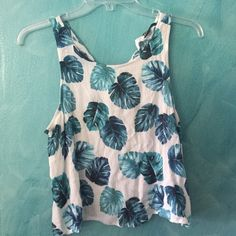 Tropical print tank Shrank a bit. Was a large but now a small Forever 21 Tops Tank Tops