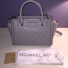 """NWT Authentic Michael Kors Selma Satchel Pearl grey smooth leather handbag. 13"""" W x 8"""" H x 4"""" D. Top zip closure, micro stud detailing. Comes with a long strap. Includes dust bag and care card. No trades. Michael Kors Bags Satchels"""