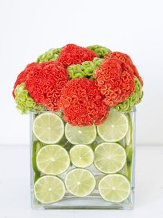 Slices of limes add a twist to this bold grouping of cockscomb flowers. If yellow is one of your wedding colors, try this arrangement with sunflowers and lemons instead.