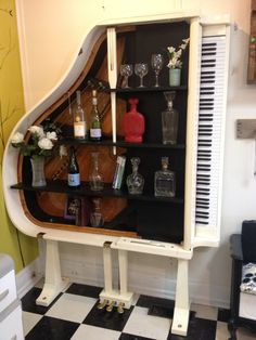 Repurposed baby grand into a piano bar! Or a great bookshelf!