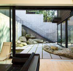 stone courtyard . hillside Mercer Island home . Hutchison & Maul Architects