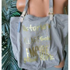 Tan Victoria Secret Tote Large canvas tote from Victoria Secret. Has canvas straps with gold hardware. Has one inside pocket with zipper. Great for the beach or lake! Victoria's Secret Bags Totes