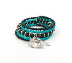 Handmade black and turquoise 5 row memory wire bracelet with glass Czech beads, Swarovski crystals, silver spacer beads, and 3 silver charms: a heart, an arrow, and a silver disc that reads Karma. **Read my FAQs below and if you have any further questions or comments please do not hesitate to contact me!**
