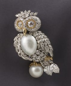 This owl brooch is designed in platinum and yellow gold. The owl has a pavé diamond head and body with large pearl accents for the chest and the perch. The diamonds are very high quality and the pearls have a beautiful luster. The date of the brooch is unknown, but it was donated in 1980, by Mrs. Henry Breyer. It is currently in the vault at the Museum. The owl is very whimsical but done in a very refined manner. Note the intricate pavé work and the attention to detail. Smithsonian…