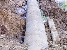 Concrete drainage pipes ...  aqueduct, build, business, cement, circular, concrete, construction, culvert, development, digging, ditch, drain, drainage, drainpipe, ducts, dust, earth, flood, ground, industrial, industry, land, layers, manufacturing, materials, piled, pipe, plumbing, road, round, sewage, sewer, site, soil, stacked, tank, tubes, water, waterspout, waterway