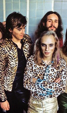 Roxy Music's Brian Ferry staring at Brian Eno's Receding Hair Line