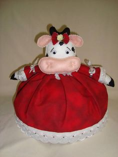 Cobre bolo de vaquinha, confeccionado em tecido e feltro. Pode ser confeccionado com tecido em outras estampas (vestido). Acompanha suporte plástico (tampa cobre bolo) R$40,00