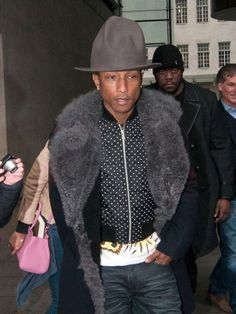 Pharrell in his Vivienne Westwood hat...so tempted to get one!