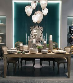 The gorgeous signature green wall in the @AnkasaHome Soho store provides a rich backdrop for the dining area, where owners Babi and Sachin Ahluwalia merchandise furniture, textiles and tabletop.