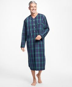 Long-sleeve nightshirt made from pure cotton. V-neck button front. Rounded hem with side vents. Piped edges. Machine wash. Imported.