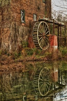 Old, deserted mill near Lindale, Ga. It was destroyed by northern troops during the Civil War and later restored, but has been out of commission for decades. Neat reflection on the water.