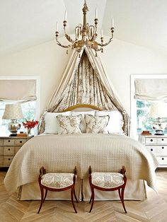 Staying in the neutral zone with a bedroom's palette could easily veer into tired territory, which is why a room fit for royalty must play with pattern and tease with texture. Even the flooring and lampshades in this bedroom vibrate with visual verve, while a mix of shiny and matte elementsmingle with the sunlight for even more playfulness.