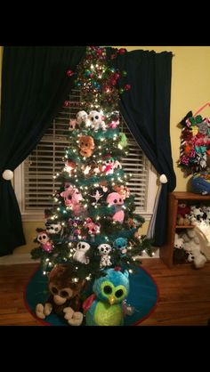 My kids beanie boo Christmas tree in her playroom(me>) I need to do this to my tree
