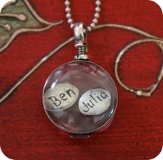 Floating locket - Tina Steinberg $135  Just need to change it to Finn & Mike