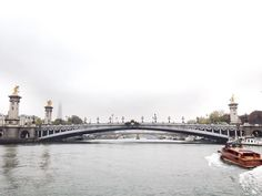 Heading somewhere for a company retreat day by the river. It's 0C and raining but with these views we don't care! #pontalexandre #laseine #merciboss by laurenloubate
