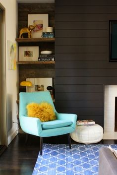 Paneled Dark Walls + Reclaimed Wood Shelves + Pops Of Color In An Otherwise Dark Room + Madeline Weinrib Indigo Brooke Carpet (Interior Design By Emily Henderson)
