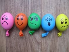 Play-doh filled stress ball balloons with emotions drawn with a Sharpie. Good calm-down strategy.